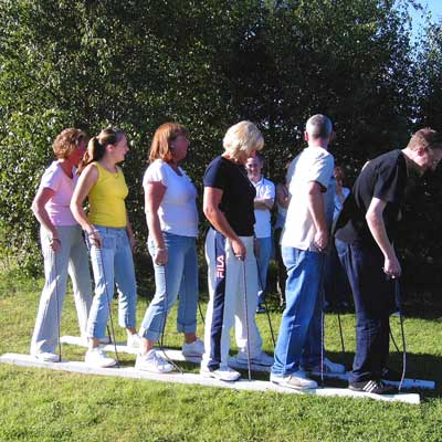 a team of six people walking on the team building activity centipede